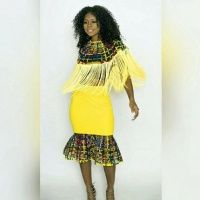 ohemaa_ankara_print_laced_bib_with_yellow_fringe_long_and_laced_skirt